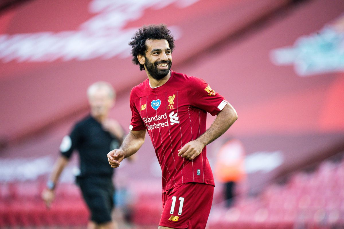 Photo of Mohamed Salah rules out transfer and wants to stay at Liverpool 'for a long time'