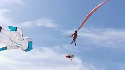 Photo of Girl thrown into air by kite in Taiwan