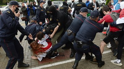 Photo of Belarus riot police attack and arrest students