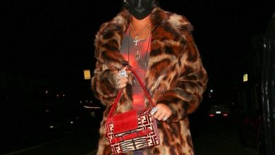 Photo of Rihanna Went Out To Dinner In A Leopard Coat, Red Midi Dress, Fendi Bag, And Baseball Cap
